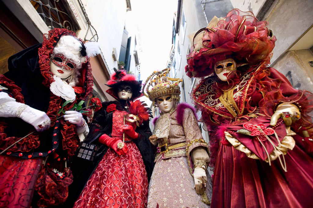 Venice Carnival with Masked revelers on the Canal