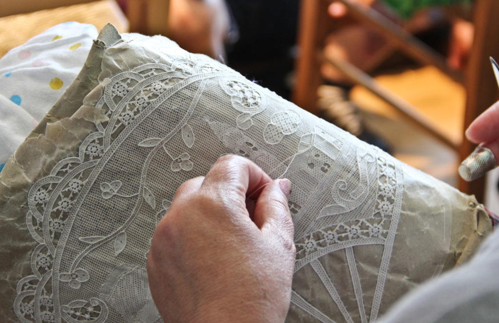 artisan making Burano Lace