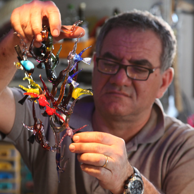 Master Holding Murano Glass Birds Figurine in Murano Italy