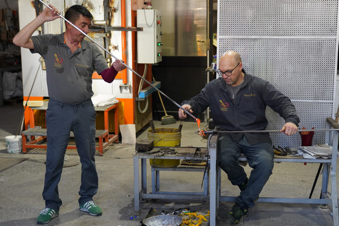 Artisans making Murano Glass vase in Murano Italy