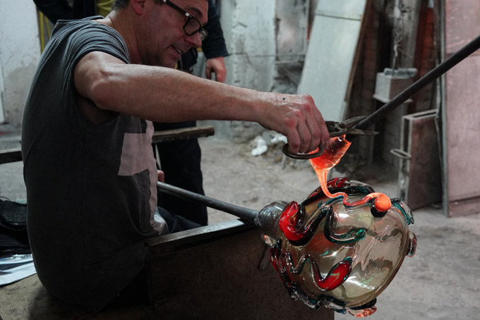 Murano Glass bowl is being made by an artisan in Murano Italy